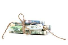 A moeda rolou nos tubos Fotografia de Stock Royalty Free