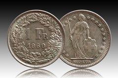 Moeda suíça 1 de Suíça um de prata do franco 1960 isolado no fundo do inclinação imagens de stock