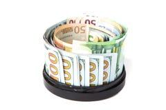 A moeda vale em torno do suporte circular Fotos de Stock