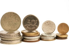 Moedas da moeda diferente Fotografia de Stock Royalty Free