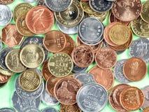 Moedas da moeda do mundo Imagens de Stock