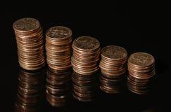 Moedas de dez centavos imagem de stock