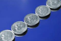 Moedas de dez centavos Imagens de Stock