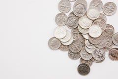 Moedas de dez centavos horizontais Fotografia de Stock