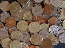 Moedas de libra, Reino Unido em Londres Foto de Stock Royalty Free