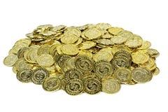 Moedas de ouro em um malote de veludo fotos de stock