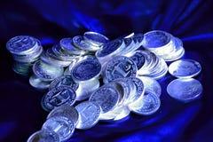 Moedas de prata Imagens de Stock