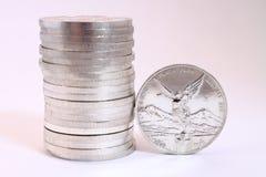 Moedas de prata mexicanas Fotografia de Stock Royalty Free