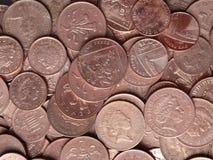 Moedas de um centavo britânicas das moedas de um centavo das moedas de cobre do close up Foto de Stock