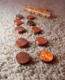 Moedas de um centavo do rolamento em envoltórios da moeda Imagens de Stock
