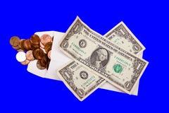 Moedas de um centavo e contas de dólar Foto de Stock Royalty Free