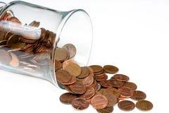 Moedas de um centavo e frasco Foto de Stock Royalty Free