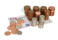 Moedas de um centavo e libras Imagens de Stock