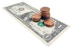 Moedas de um centavo no dólar Imagem de Stock