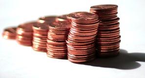 Moedas de um centavo que desvanecem-se afastado Foto de Stock