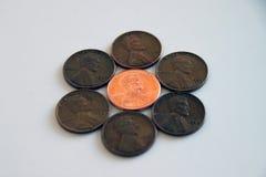Moedas de um centavo - velhas e novas Fotos de Stock