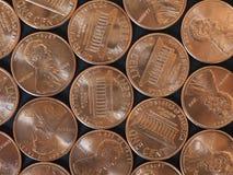 Moedas de um dólar do centavo, Estados Unidos sobre o preto Foto de Stock
