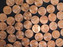 Moedas de um dólar do centavo, Estados Unidos sobre o preto Imagens de Stock Royalty Free