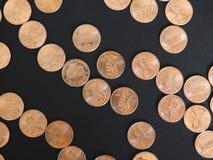 Moedas de um dólar do centavo, Estados Unidos sobre o preto Fotografia de Stock