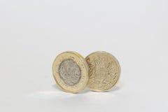 Moedas de uma libra novas e velhas Fotografia de Stock Royalty Free