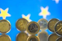 Moedas do Euro em um fundo azul fotografia de stock royalty free