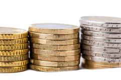 Moedas do Euro em um fundo branco Imagem de Stock