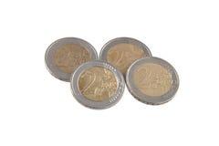 Moedas do Euro em um fundo branco liso Imagens de Stock