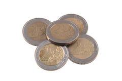 Moedas do Euro em um fundo branco liso Fotografia de Stock Royalty Free