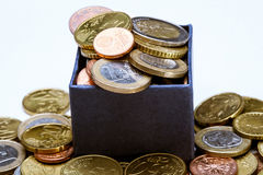 Moedas do Euro na caixa azul Imagem de Stock Royalty Free