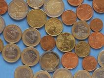 Moedas do Euro, União Europeia sobre o azul Fotografia de Stock