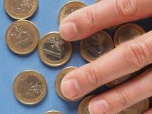 Moedas do Euro, União Europeia sobre o azul Foto de Stock Royalty Free