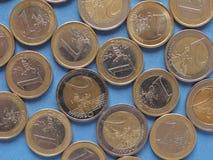 Moedas do Euro, União Europeia sobre o azul Imagem de Stock
