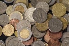 Moedas dos países diferentes Fundo agradável do dinheiro imagem de stock royalty free