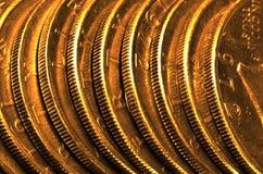 Moedas e barras de ouro Fotografia de Stock