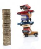 Moedas e carros Fotografia de Stock Royalty Free
