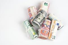 Moedas e conceitos de troca da troca de dinheiro Os rolos do dif fotografia de stock royalty free
