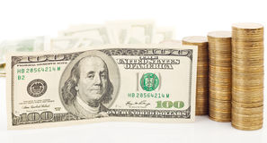 Moedas e dólar Fotos de Stock Royalty Free