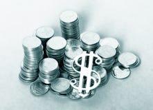 Moedas e dólar Fotografia de Stock Royalty Free