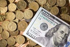 Moedas e dólares Imagens de Stock