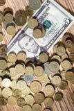 Moedas e dólares Foto de Stock