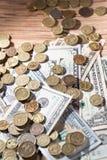 Moedas e dólares Imagens de Stock Royalty Free