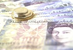 Moedas e notas britânicas Fotografia de Stock Royalty Free