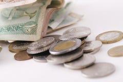 Moedas e notas de banco Imagem de Stock