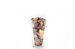 Moedas em um vidro da água Imagem de Stock Royalty Free
