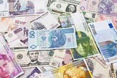 Moedas internacionais Imagens de Stock