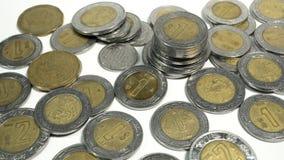 Moedas mexicanas dos pesos, as velhas e danificada de México foto de stock royalty free