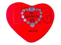 Moedas simbólicas da união no coração vermelho Fotografia de Stock