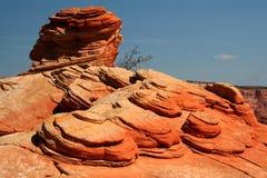 Moedas vermelhas da rocha Fotografia de Stock Royalty Free
