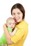 Moeder die jonge baby houdt Stock Fotografie