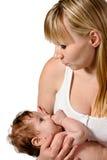 Moeder en baby in haar wapens Stock Foto